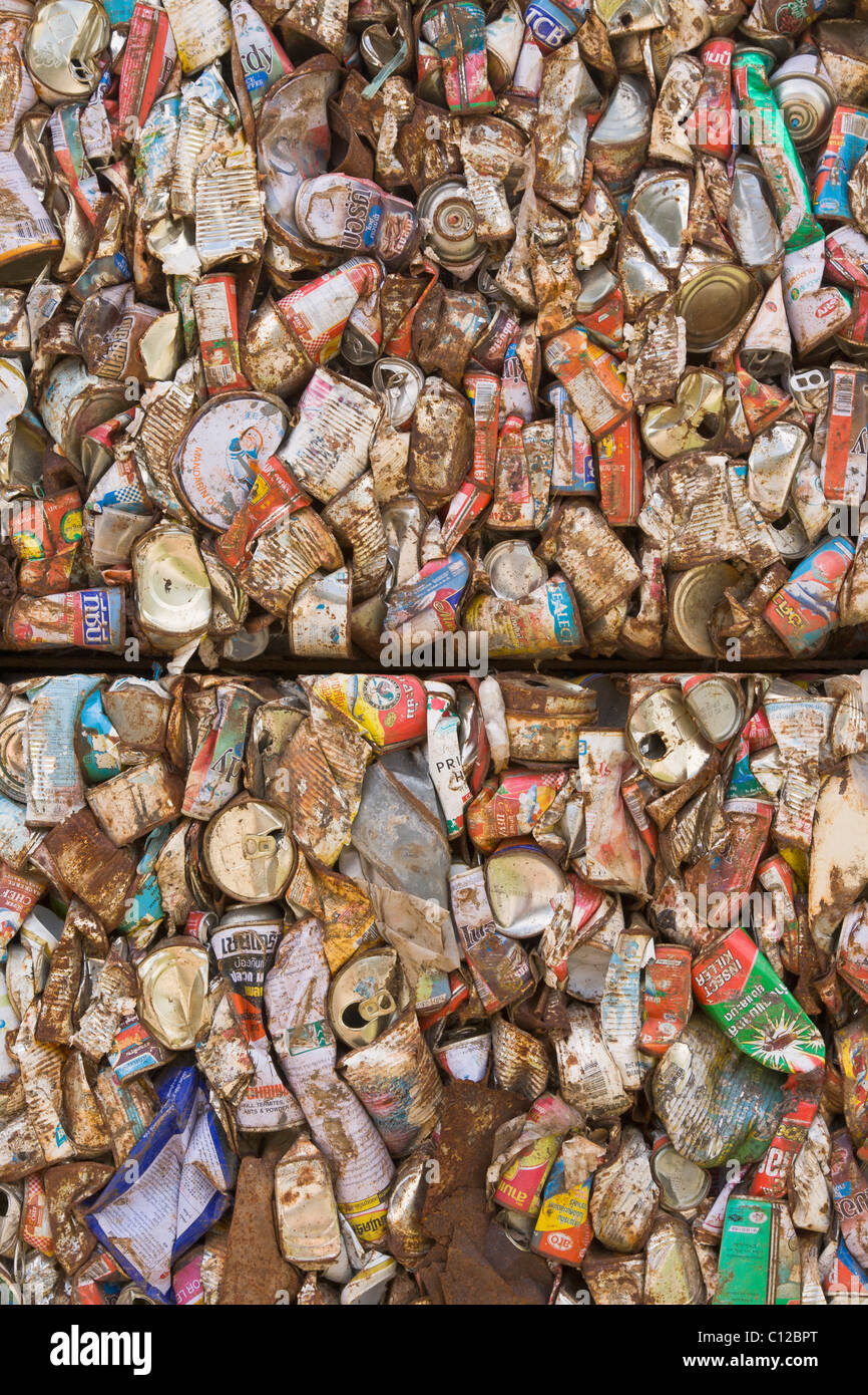 Recycled aluminum cans flattened and crushed - Stock Image