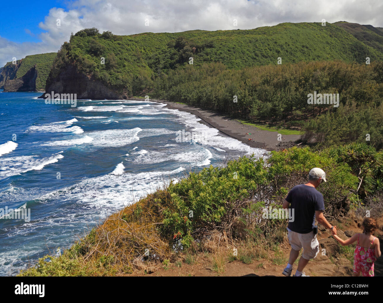 Hikers on the Pololu Valley trail on the Big Island Stock Photo