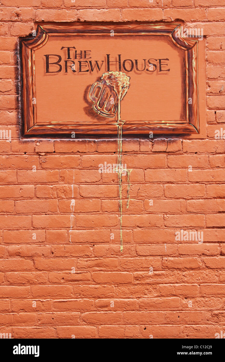 Sign for The Brew House. A bar in North Manchester, Indiana, USA. Near three dimensional painting on a brick wall. - Stock Image