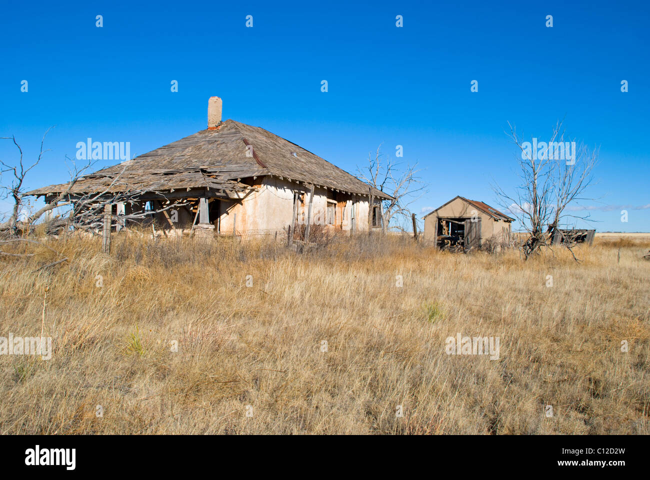 Wind and weather help destroy an abandoned house in a very rural area of New Mexico. - Stock Image