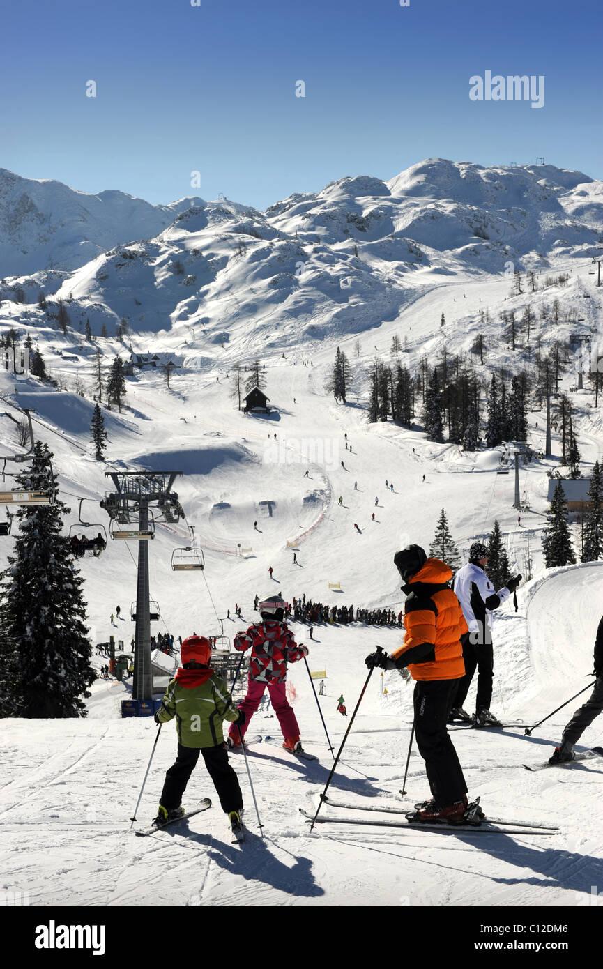 Skiers at the Vogel Ski Centre in the Triglav National Park of Slovenia - Stock Image