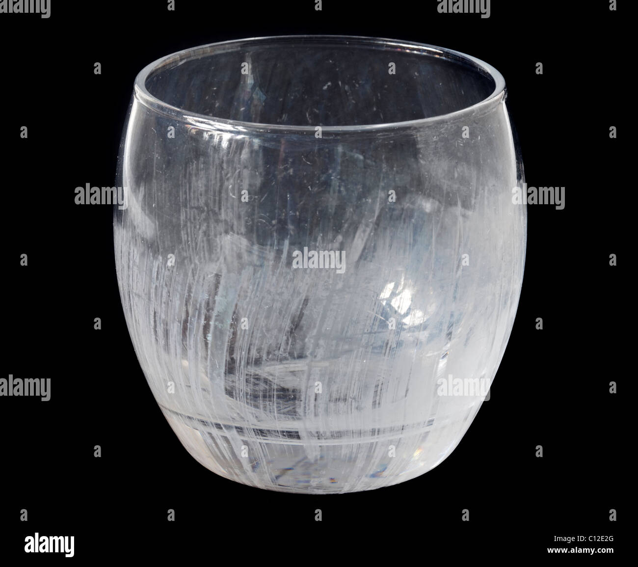 Glass Tumbler showing limescale/etching from frequent dishwashing - Stock Image