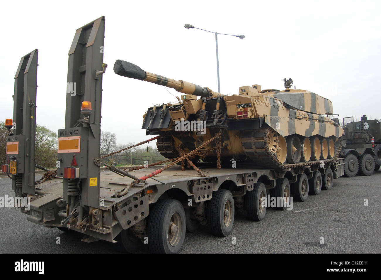 a93f03b4c9d5 FV4034 Challenger 2 is a main battle tank (MBT) currently in service with  the armies of the United Kingdom on a tank transporter
