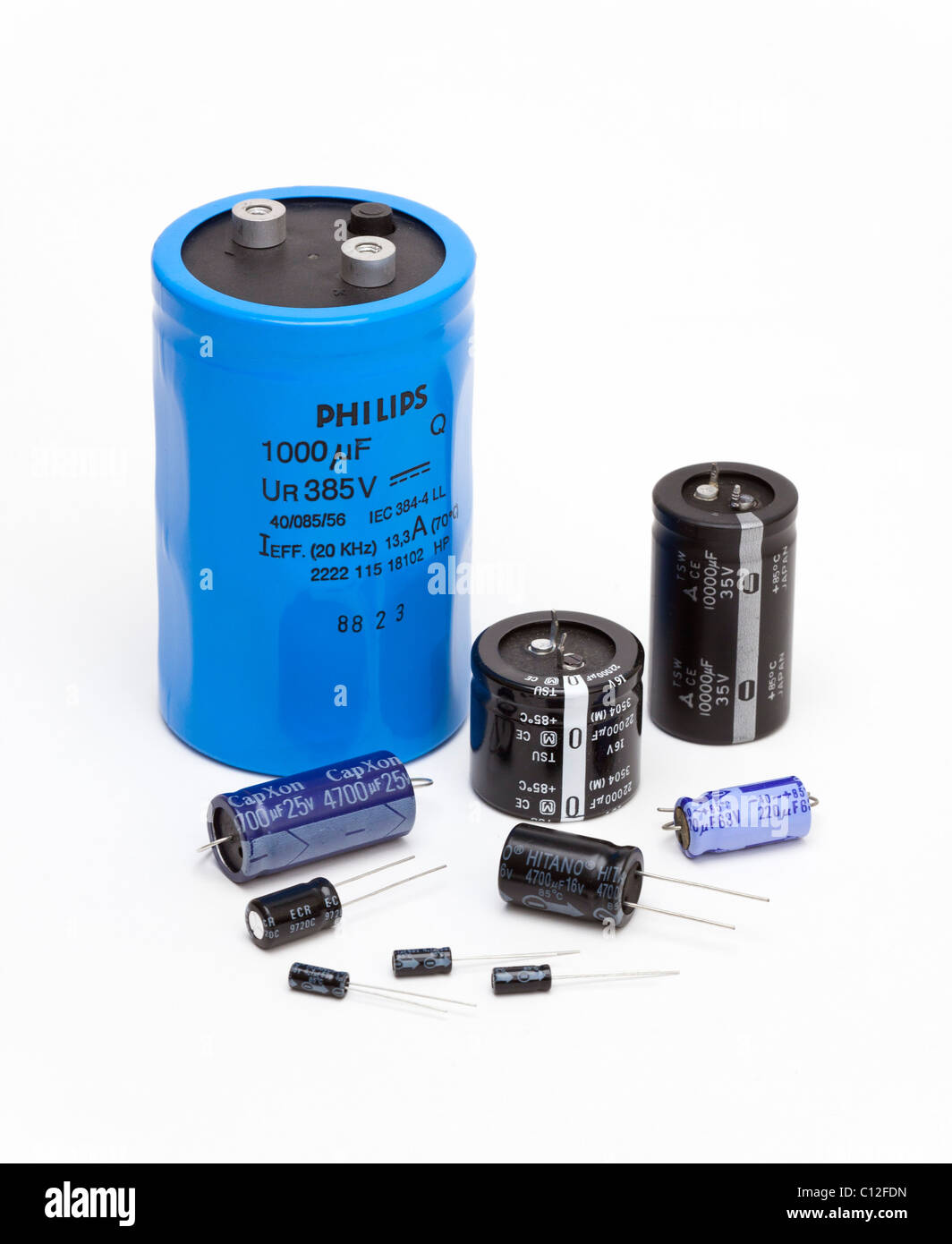 various size electrolytic capacitors - Stock Image