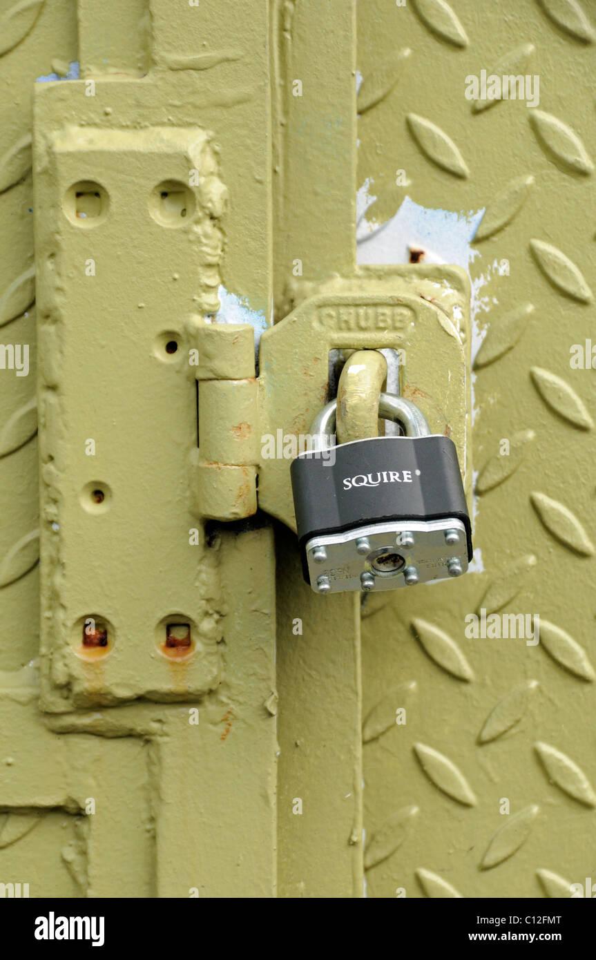 Squire Padlock on industrial door - Stock Image