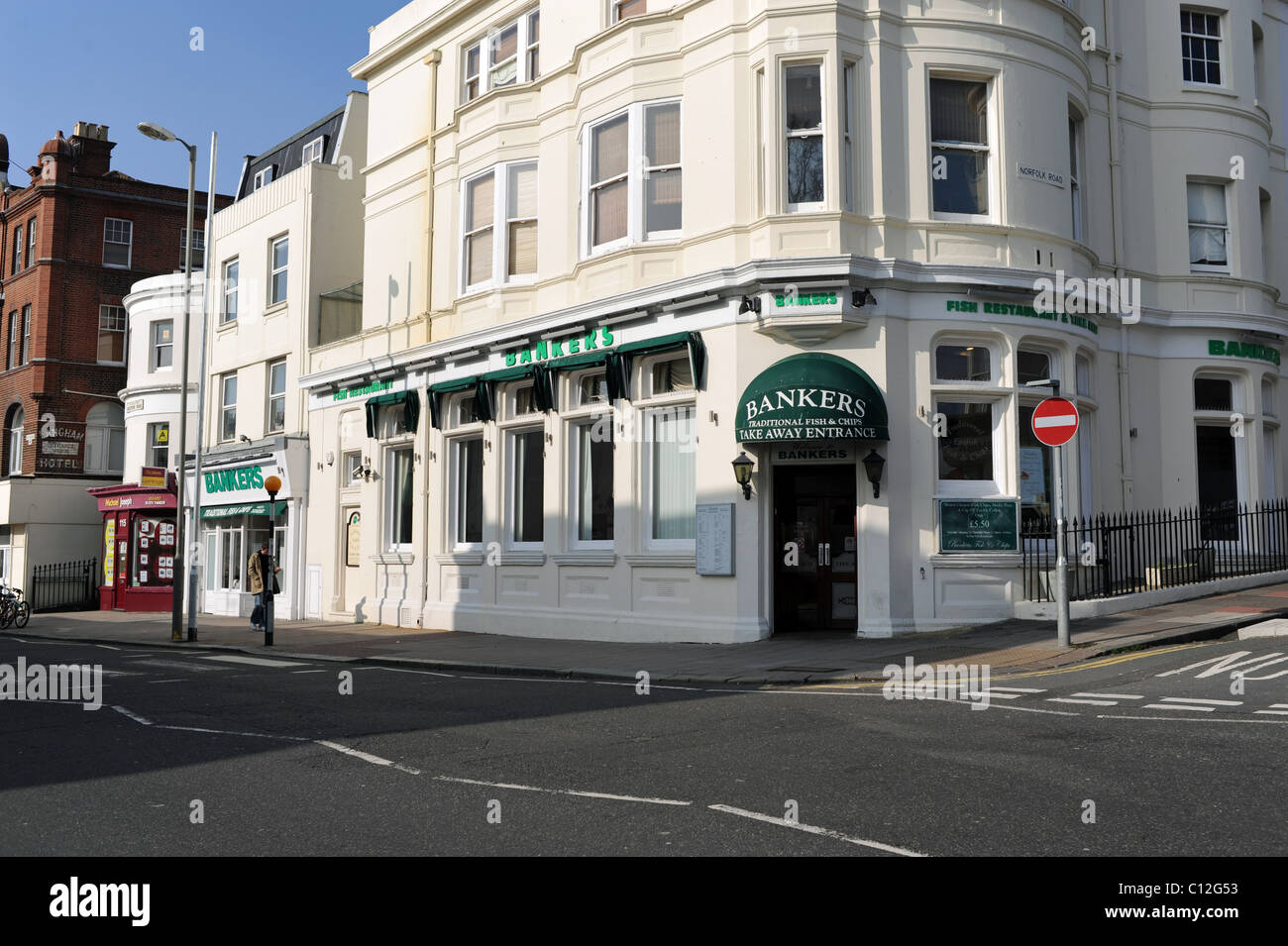 Bankers fish and chip take away restaurant in Brighton the building formerly being a bank - Stock Image