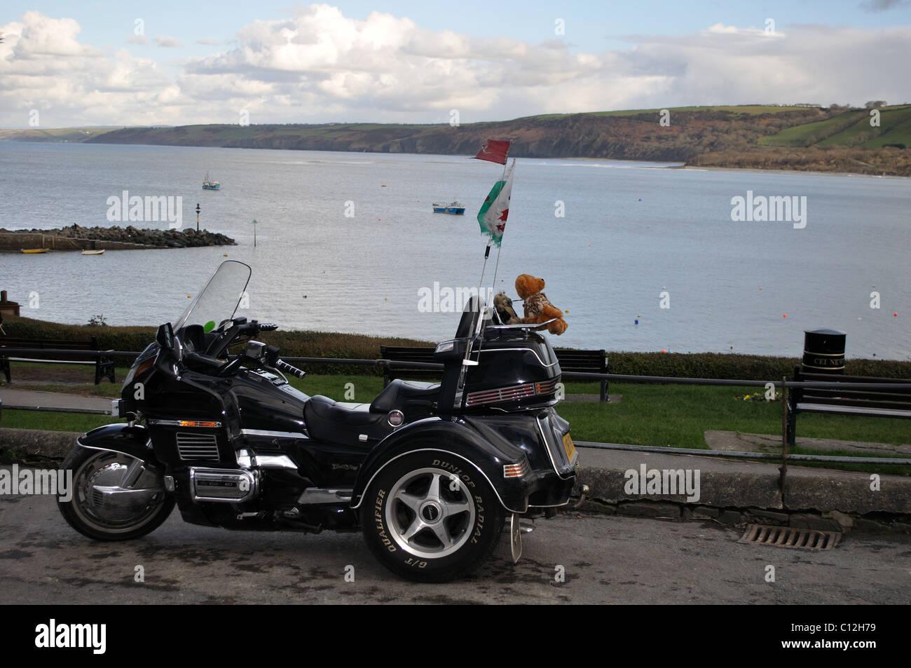 Three wheel motorbike with teddy bear on back, Newquay, Ceredigion, Wales, United Kingdom Stock Photo