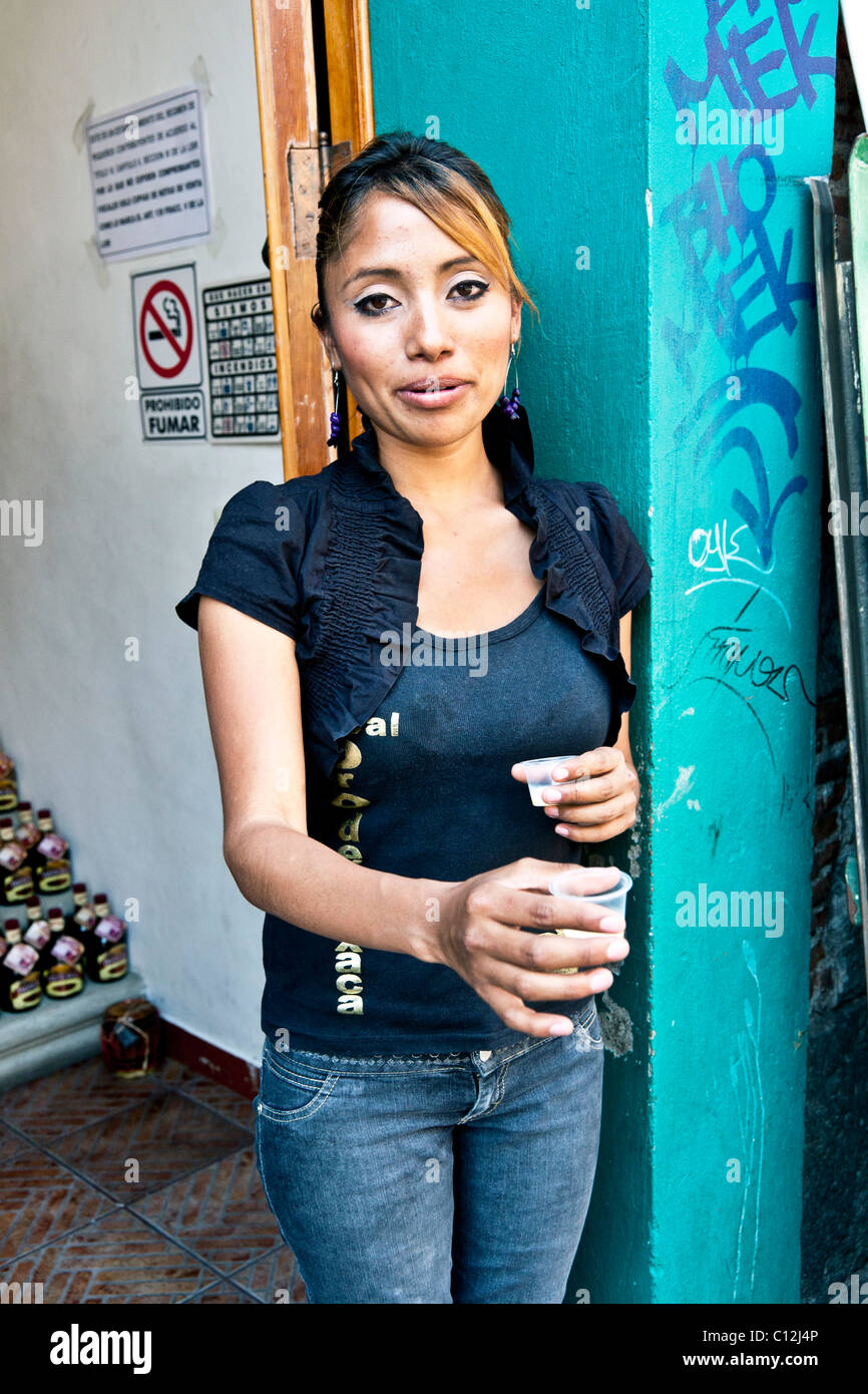 winsome shapely young mexican woman in tight jeans & tee shirt stock