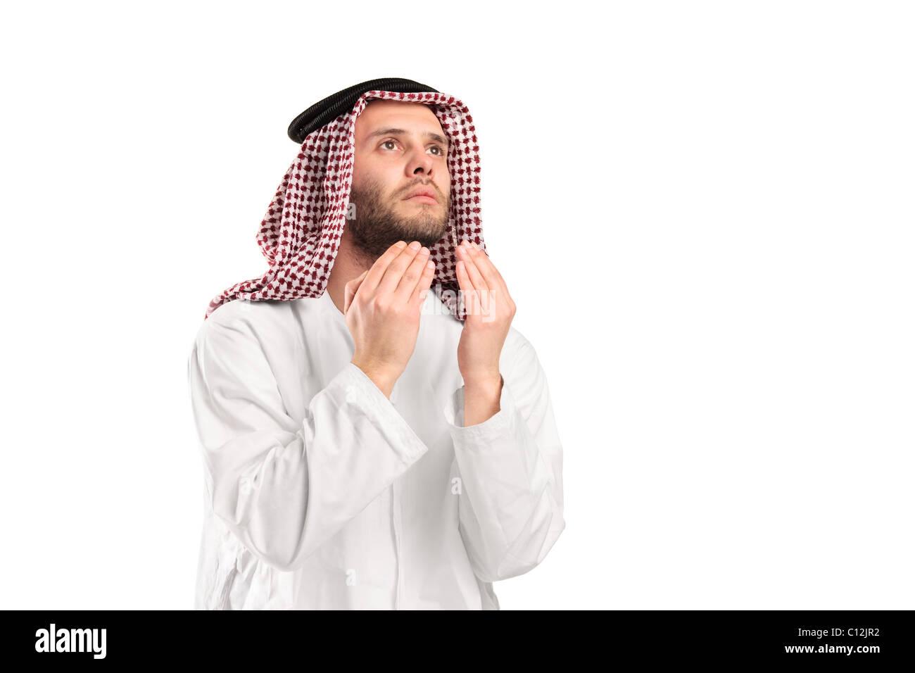 Young arab man of muslim religion praying - Stock Image