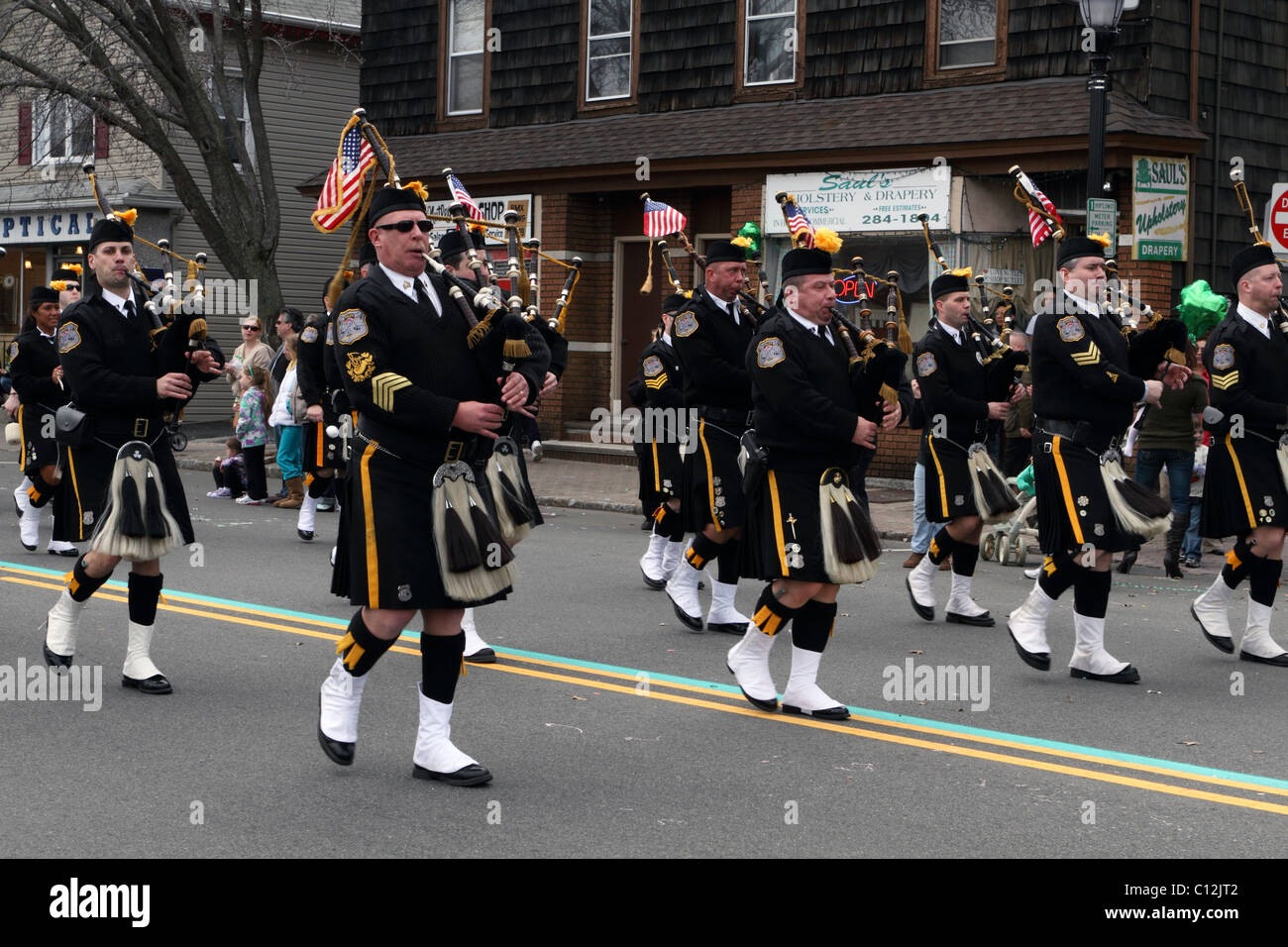Morris County Police Pipes and Drum corp marching in the local St Patrick's Day Parade. Nutley, New Jersey, - Stock Image