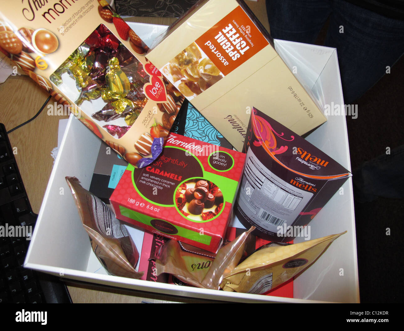 hamper box filled with Thornton's chocolates - Stock Image