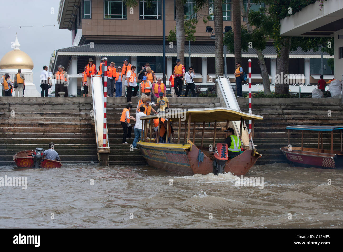 Tourists Boarding Boat on Brunei River - Stock Image