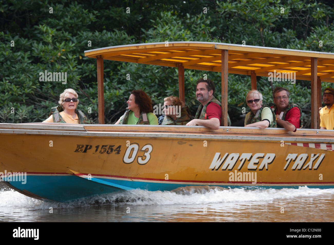 Water Taxi with Passengers on Brunei River - Stock Image