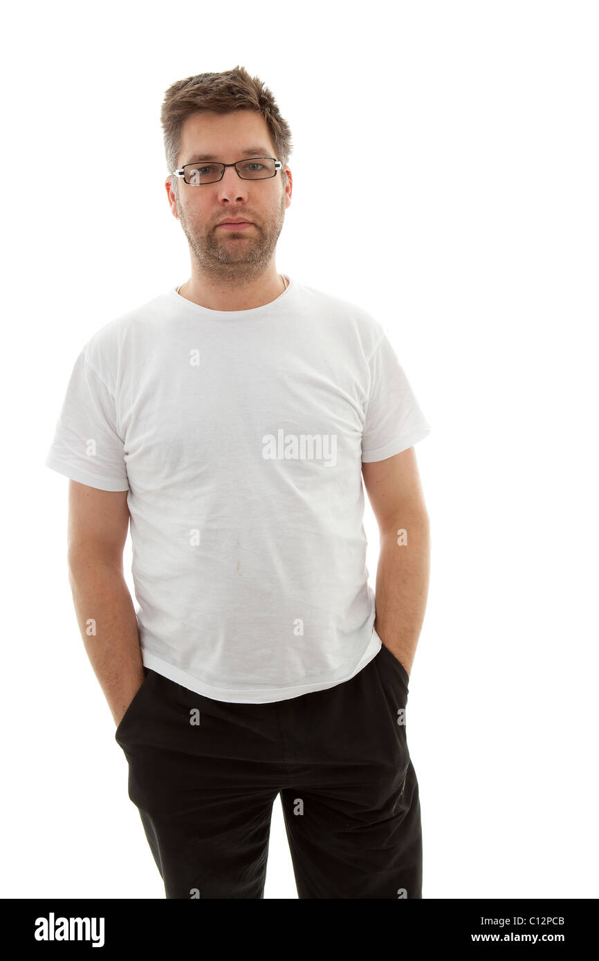 Unshaved man looking into camera over white background - Stock Image