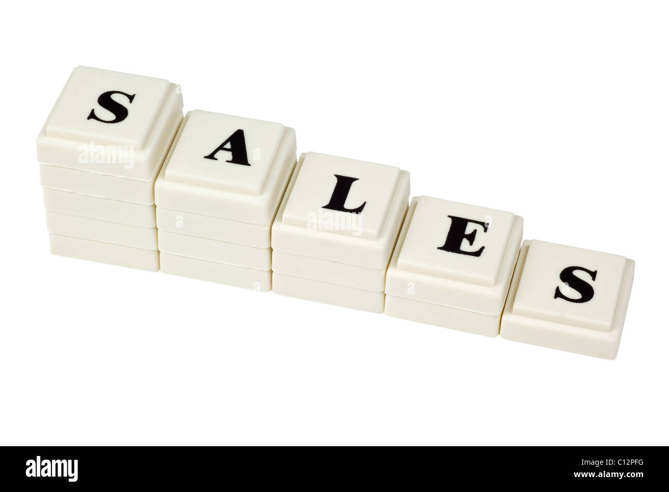 Stack of decreasing blocks showing the word SALES isolated on white background - Stock Image