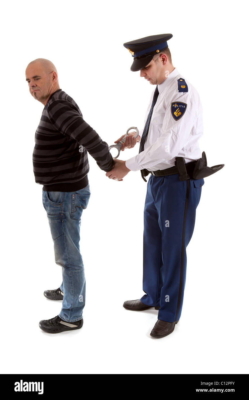 police agent is making a arrest over white background - Stock Image