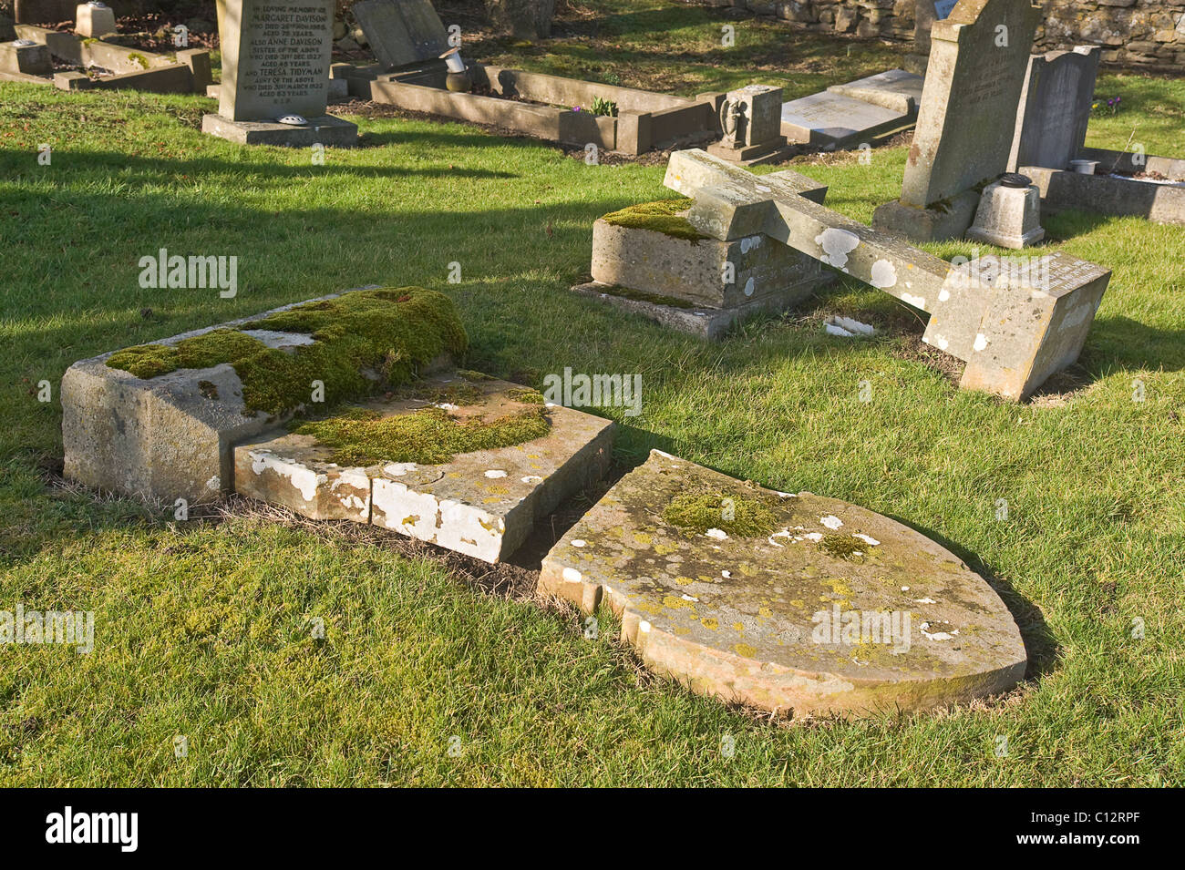 Grave stones flattened in the name of safety. Churchyard in Yorkshire. - Stock Image