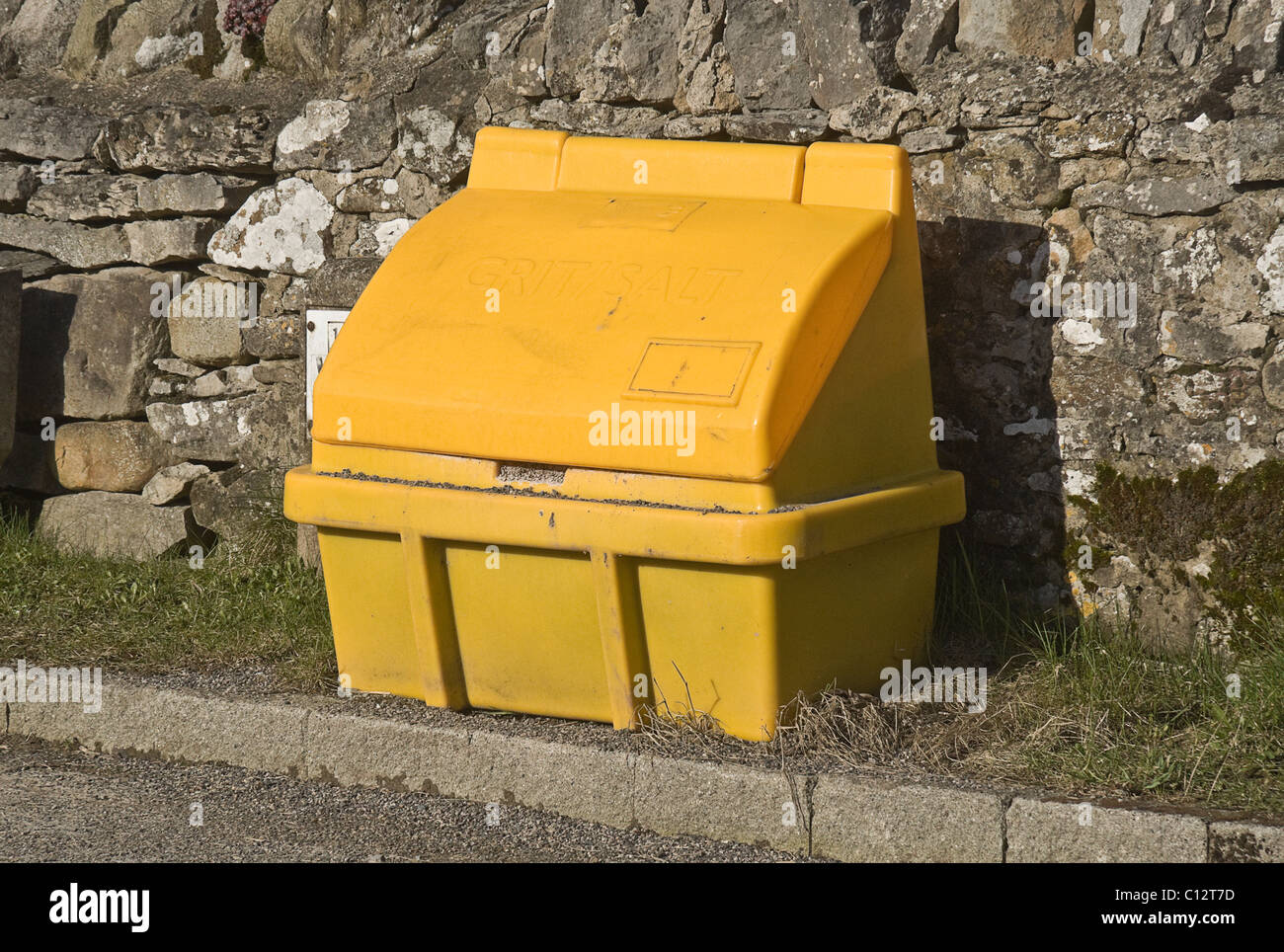 Yellow grit box by the side of a village road in Yorkshire - Stock Image