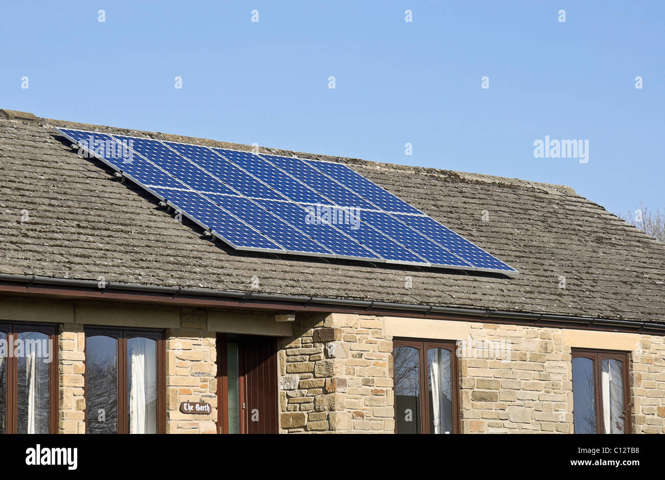 Solar panels on a modern bungalow in Yorkshire, UK - Stock Image