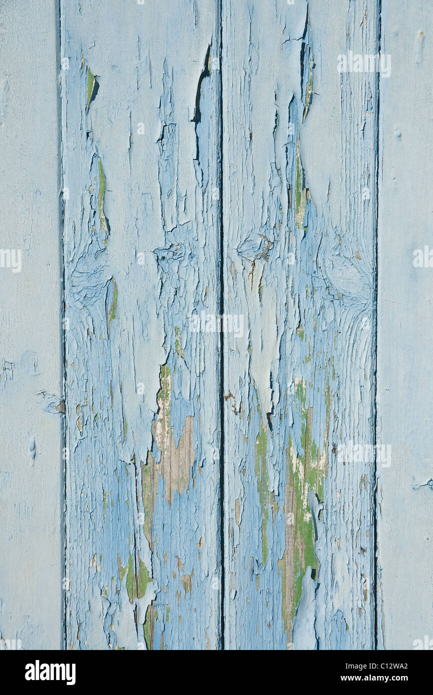Peeling paint on a neglected garage door. - Stock Image