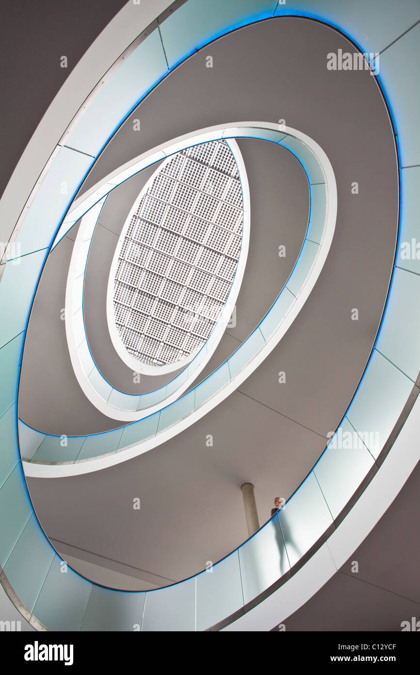 low angle view into staircase of office building - Stock Image