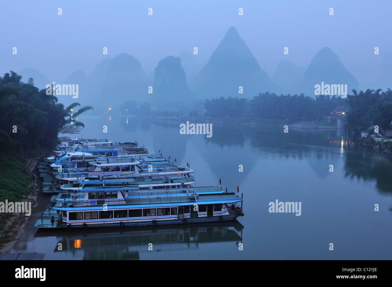 ships on Li River at Yangshuo in Guilin region of China - Stock Image