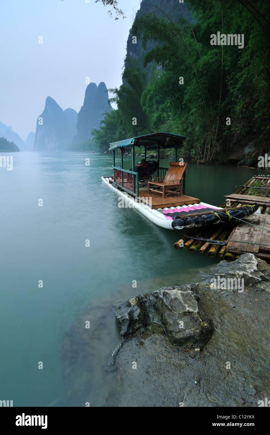 tourist boat on Li River near Yangshuo in Guilin region of China - Stock Image