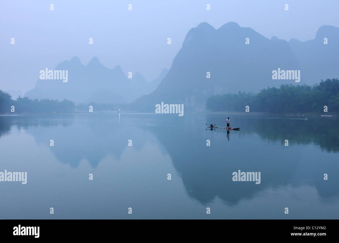 fisherman on Li Rivernear Yangshuo in Guilin region of China - Stock Image