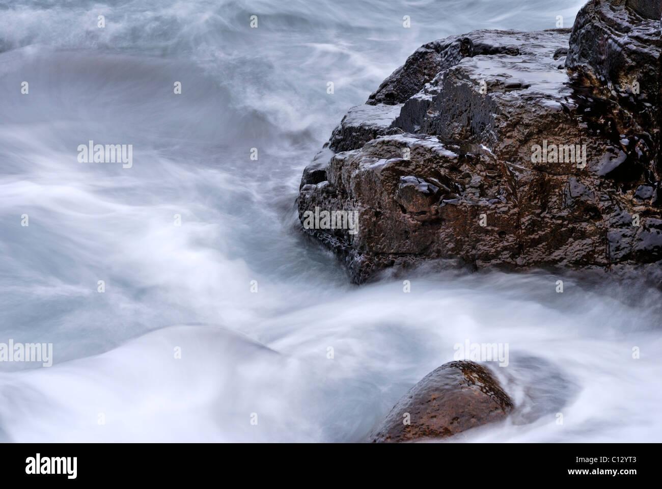 rocks in black sea water near blue bay on crimea Stock Photo