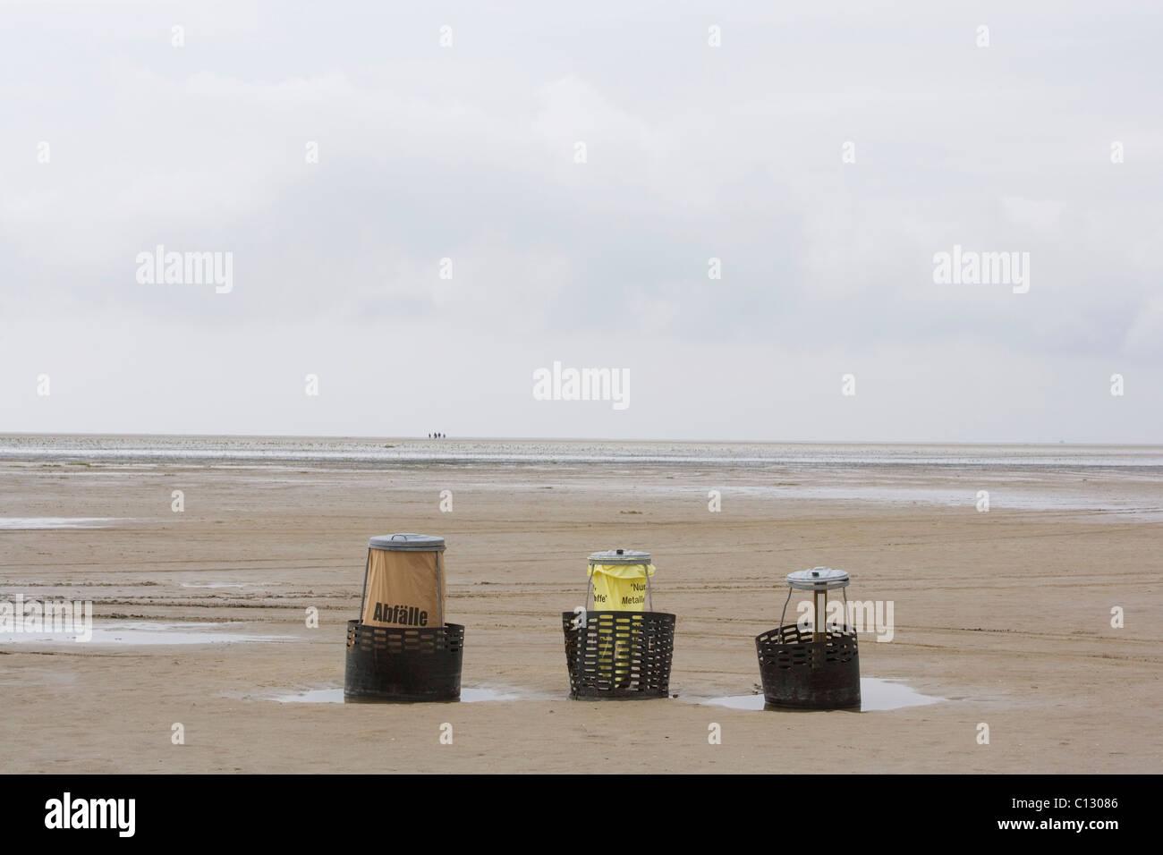 wastebaskets on empty beach - Stock Image