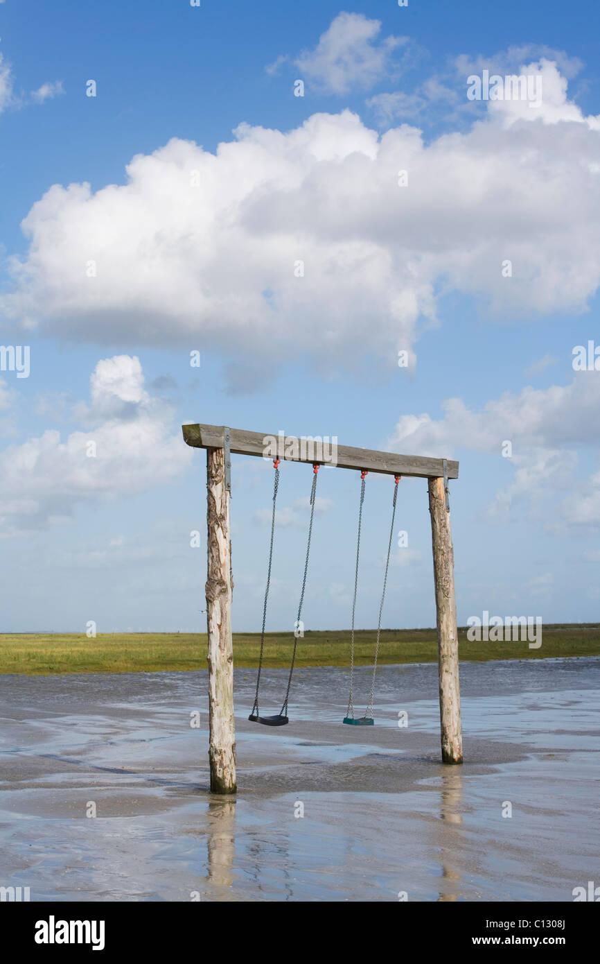 swings on empty beach - Stock Image