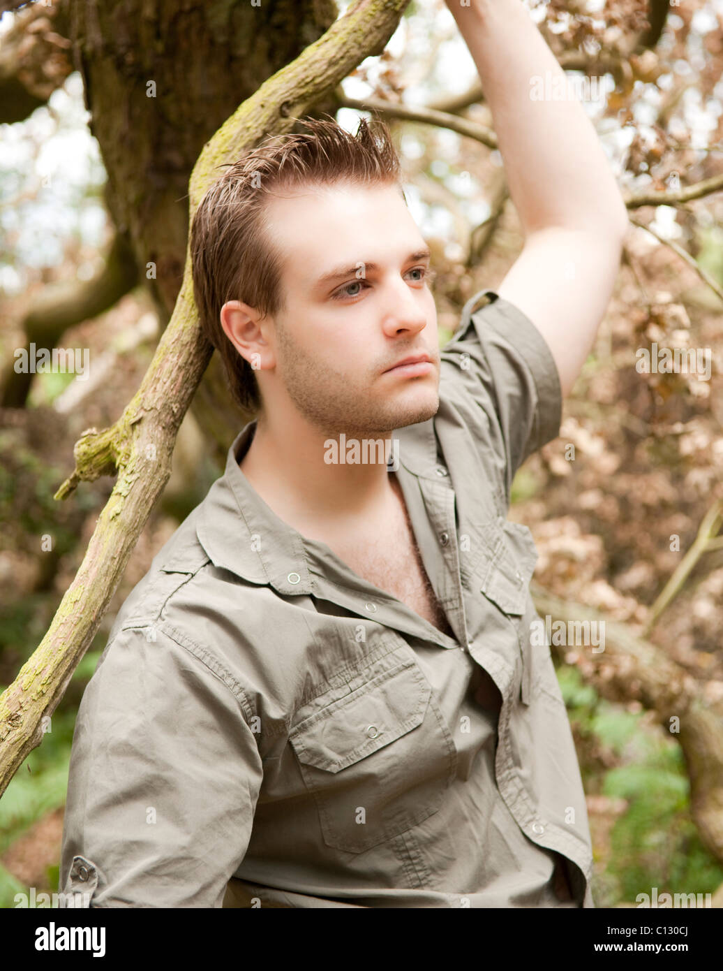 portrait of young man in a forest - Stock Image