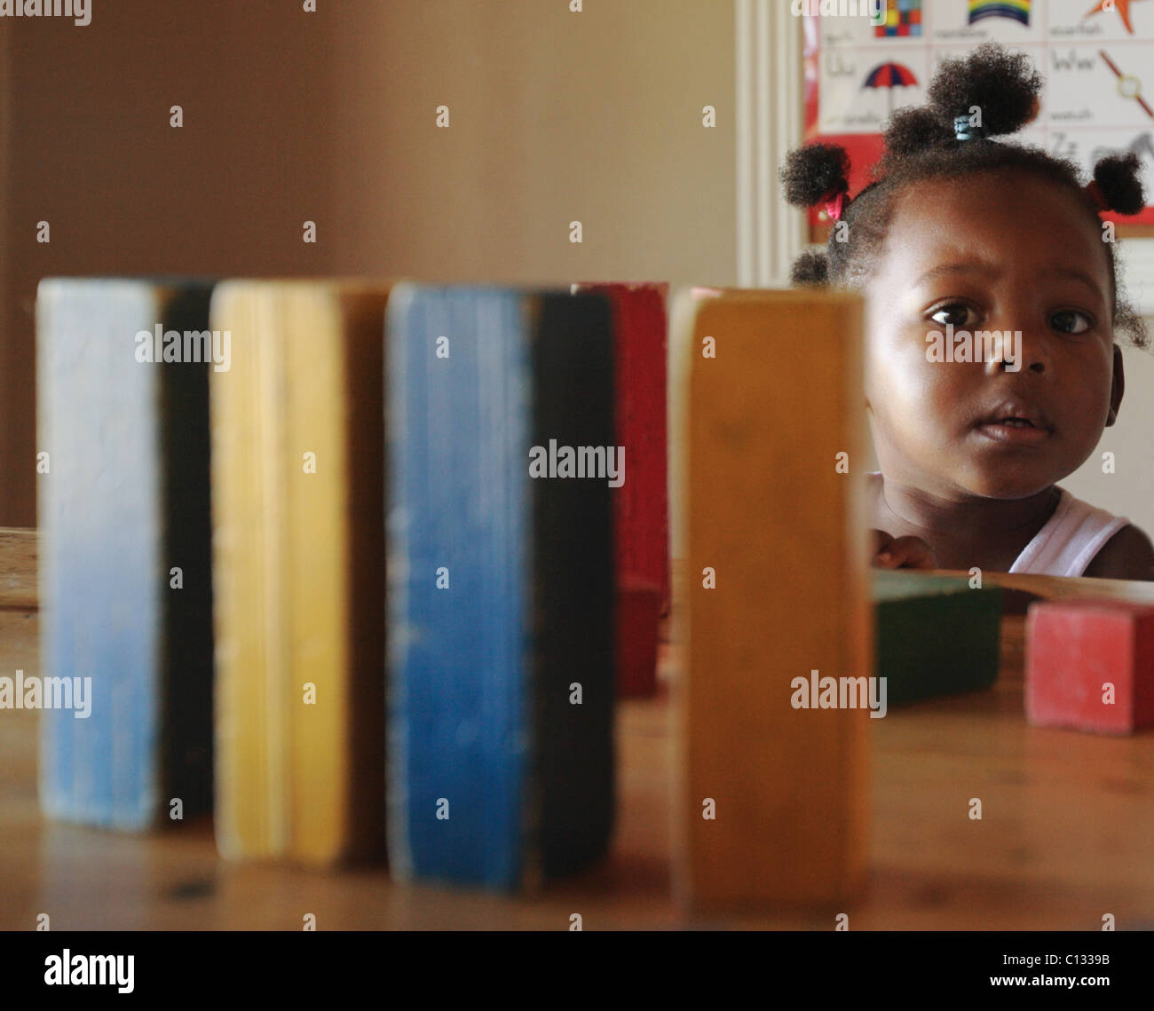 Girl (18-23 months) with building blocks, Cape Town, Western Cape Province, South Africa - Stock Image