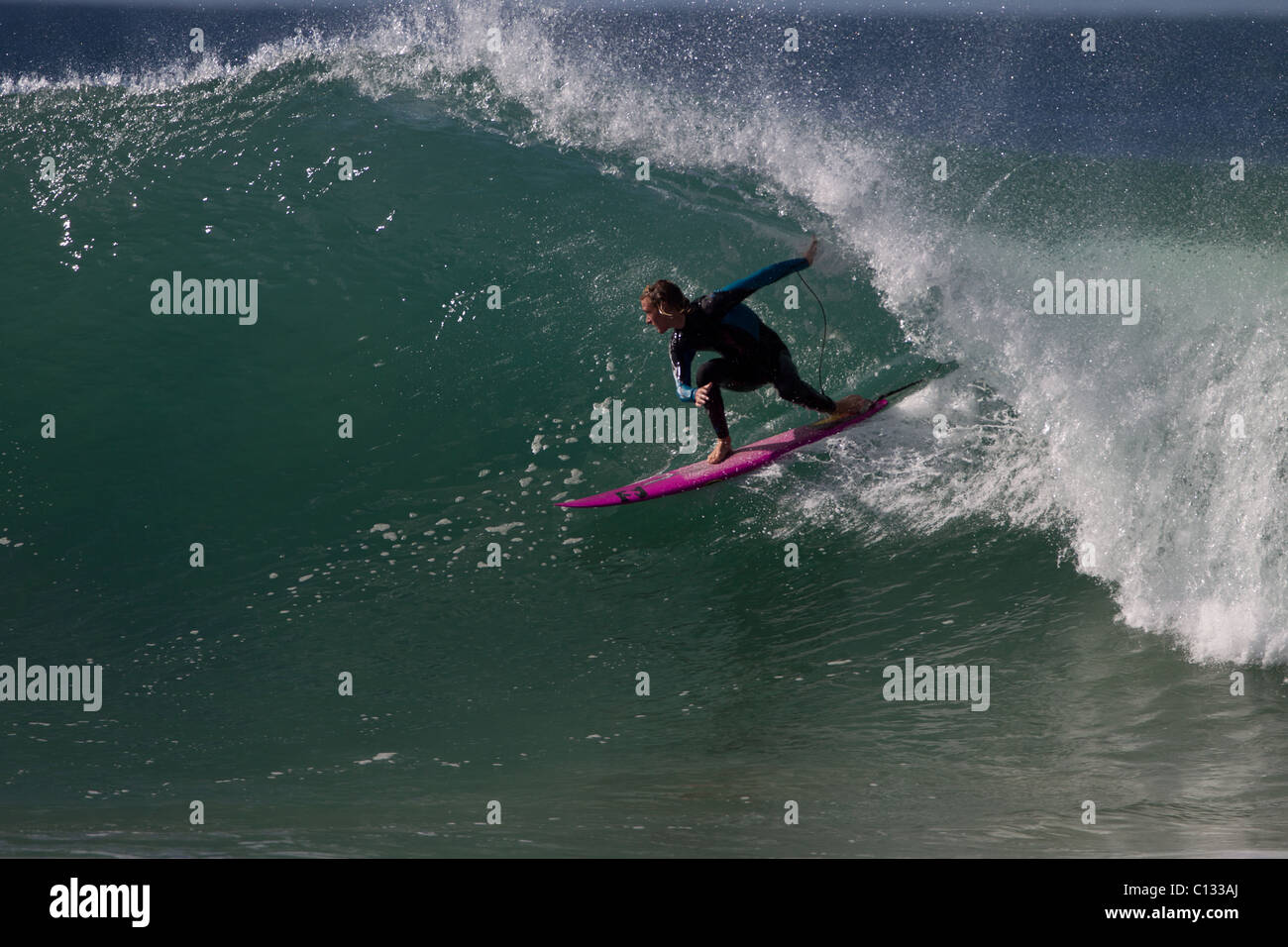 Backside Tube Ridng at Supers, Jeffreys Bay, South Africa - Stock Image