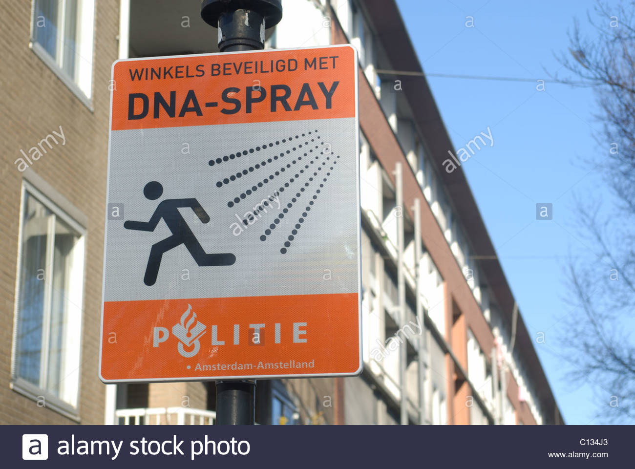 Amsterdam Sign 'Shops secured with DNA spray' (See description) - Stock Image