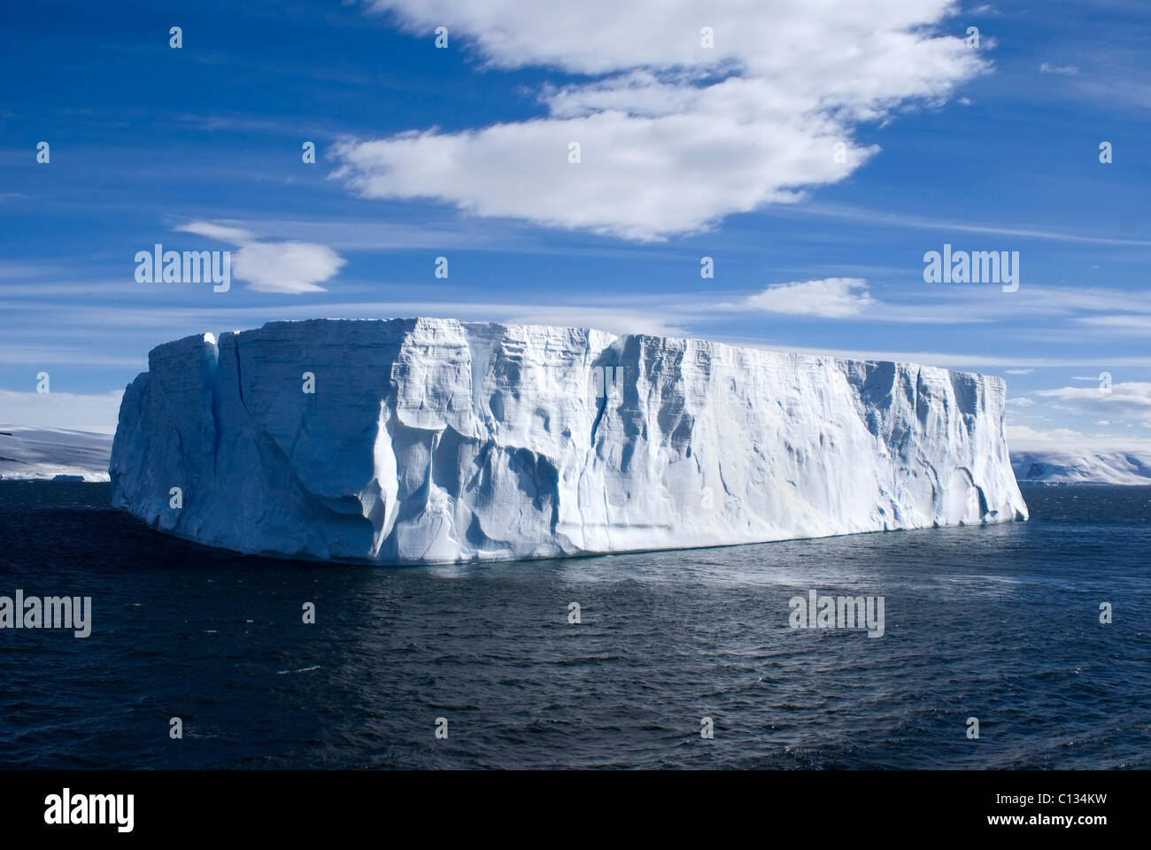 Large tableture iceberg with clear blue sky taken at Antarctica. - Stock Image