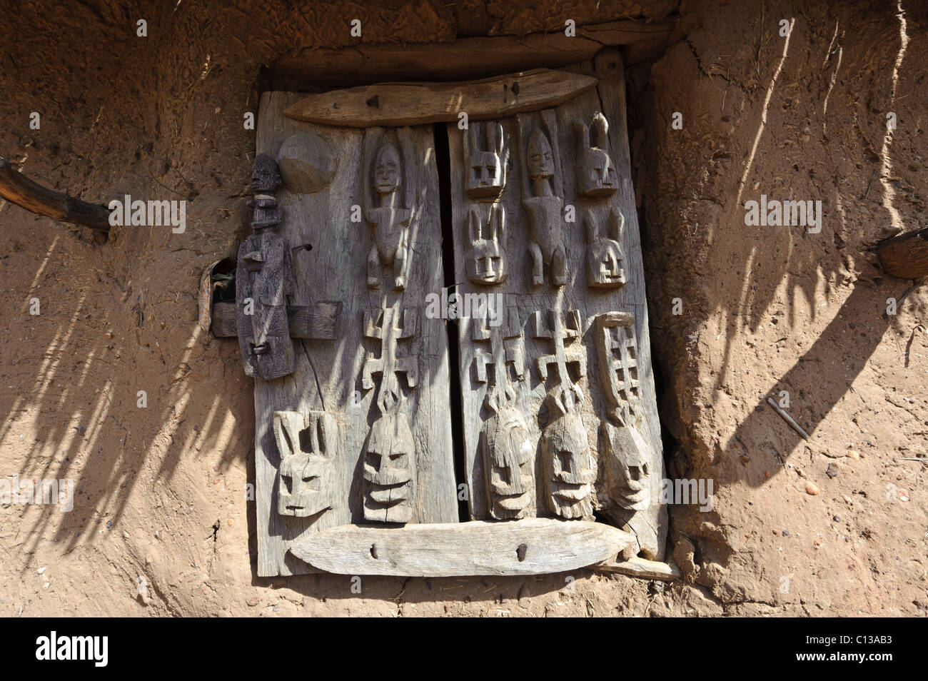 Granary door with carved Dogon wooden door lock. Begnemato village on Gondo plain. Dogon Plateau Pays Dogon Mali. & Granary door with carved Dogon wooden door lock. Begnemato village ...