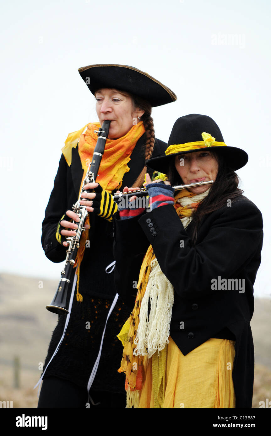 two female musicians playing in a cornish folk band on st.pirans day in cornwall, uk - Stock Image