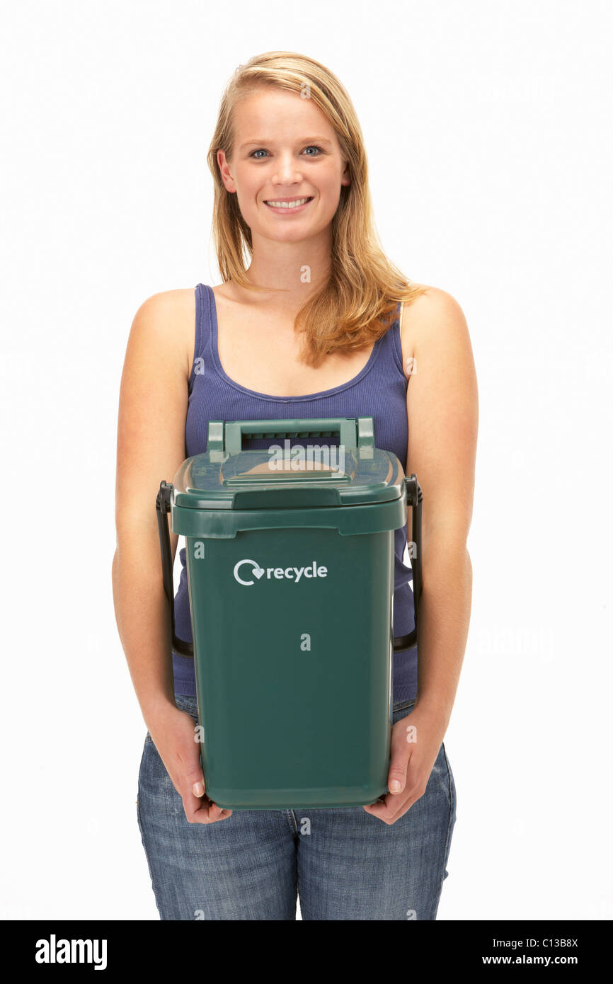 Young woman holding recycling container - Stock Image