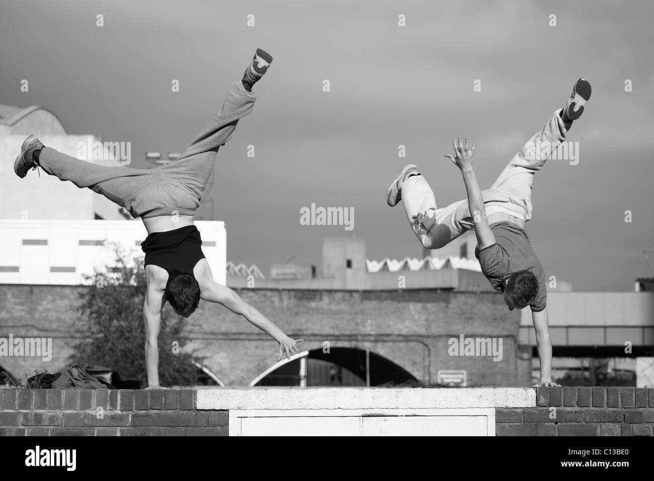 Two teenage boys practice free running - Stock Image