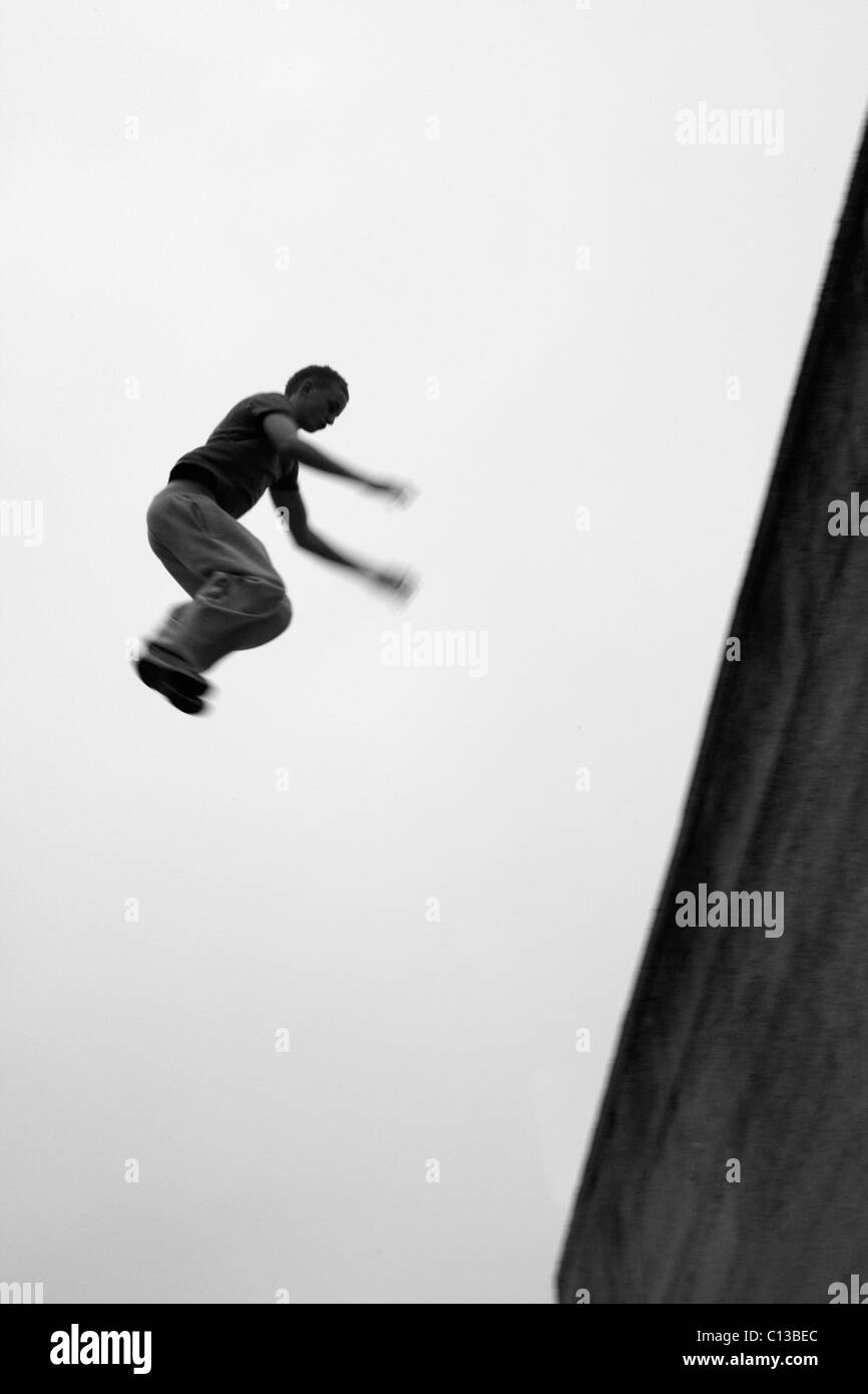 Teenage boy practicing free running - Stock Image