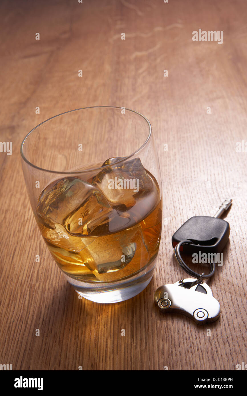 A glass of alcohol and car keys - Stock Image
