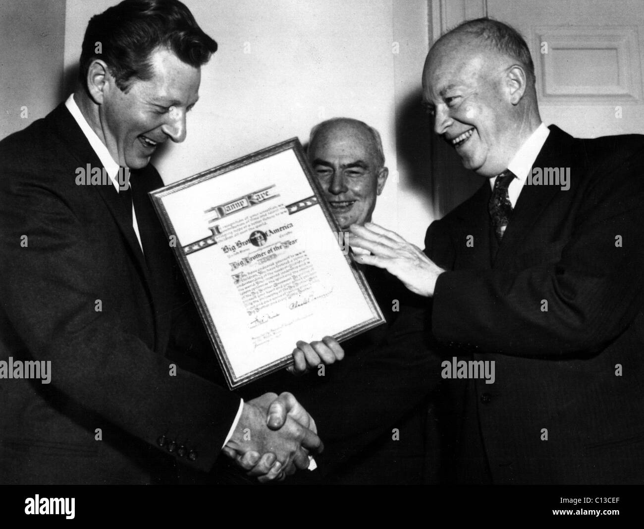 DANNY KAYE, named Big Brother of the Year, is congratualted at the White House by CHARLES BERWIND and President - Stock Image