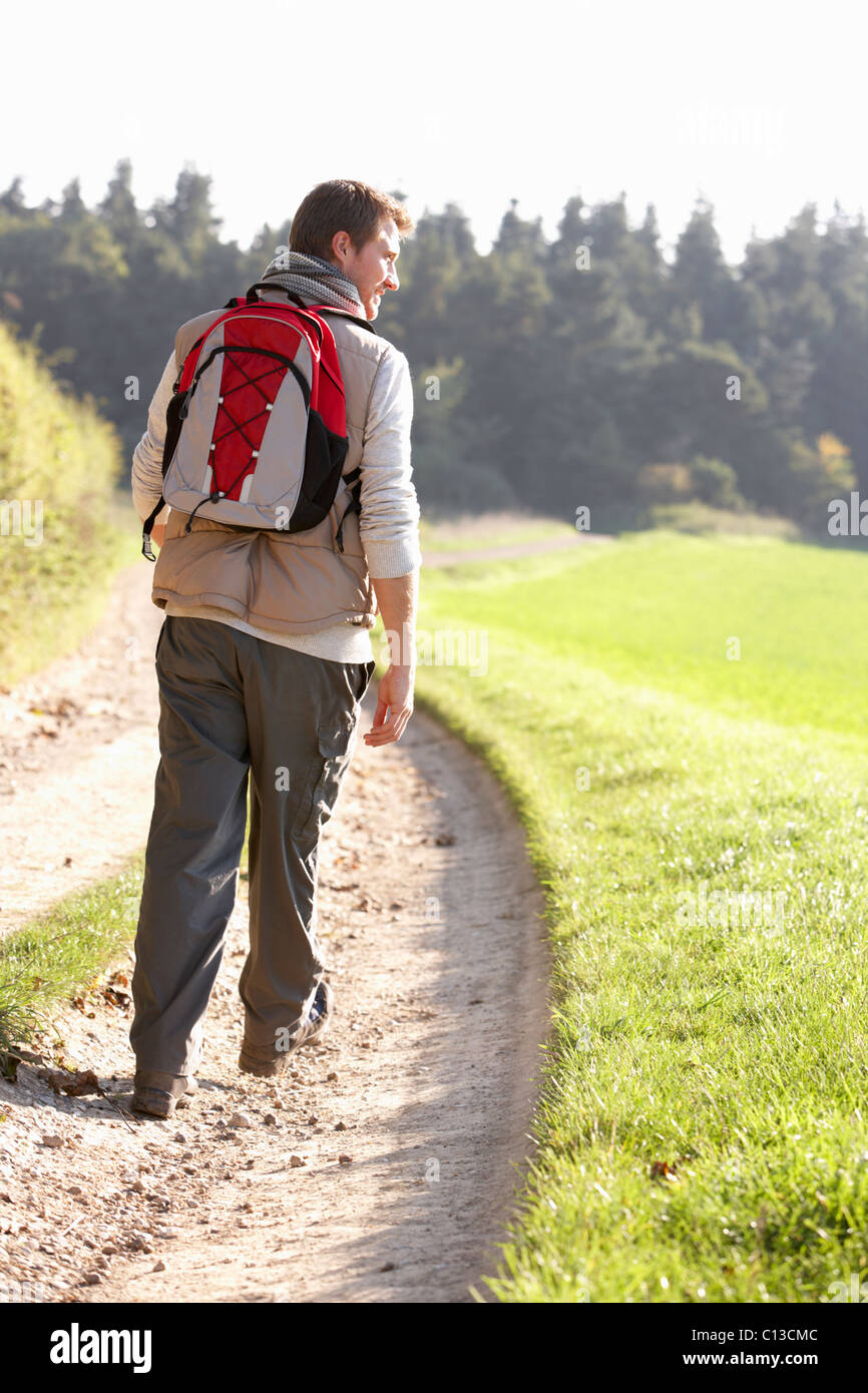 Young man walks in park Stock Photo