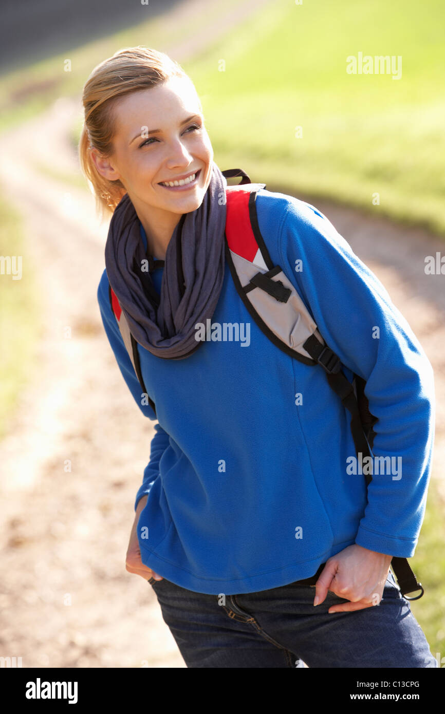 Young woman poses in park - Stock Image