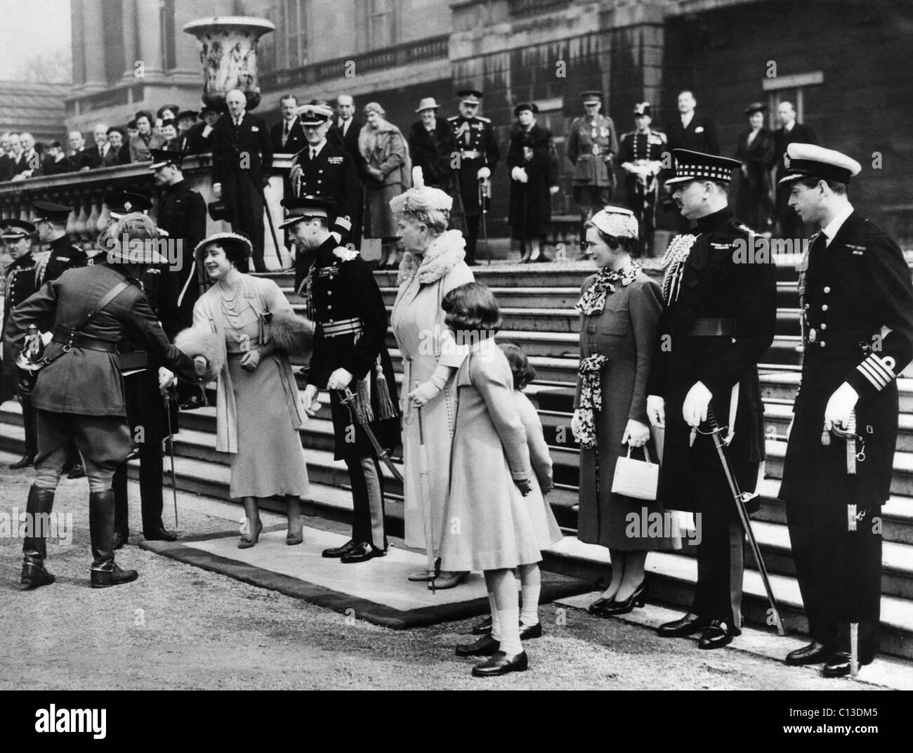 Queen Elizabeth (front, second from left), the former Duchess of York, King George VI (front, third from left), - Stock Image