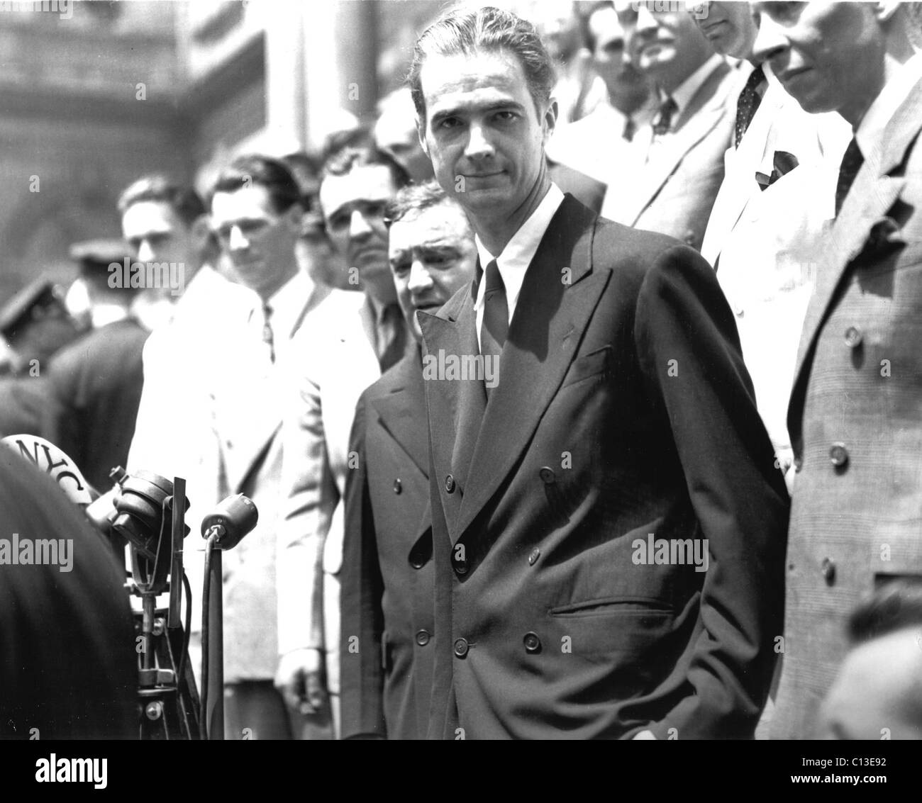 Howard Hughes honored in NYC for his round the world flight of 3 days, 19 hours, 17 mins. Mayor LaGuardia behind, - Stock Image