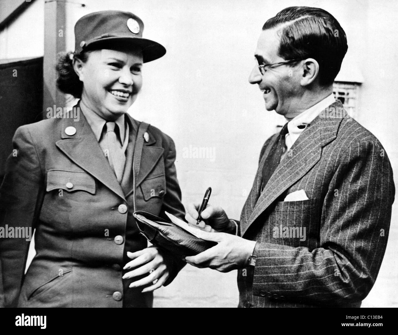 Irving Berlin gives autograph to Sybile Kinsey after his arrival for rehearsals of 'This Is The Army' at - Stock Image