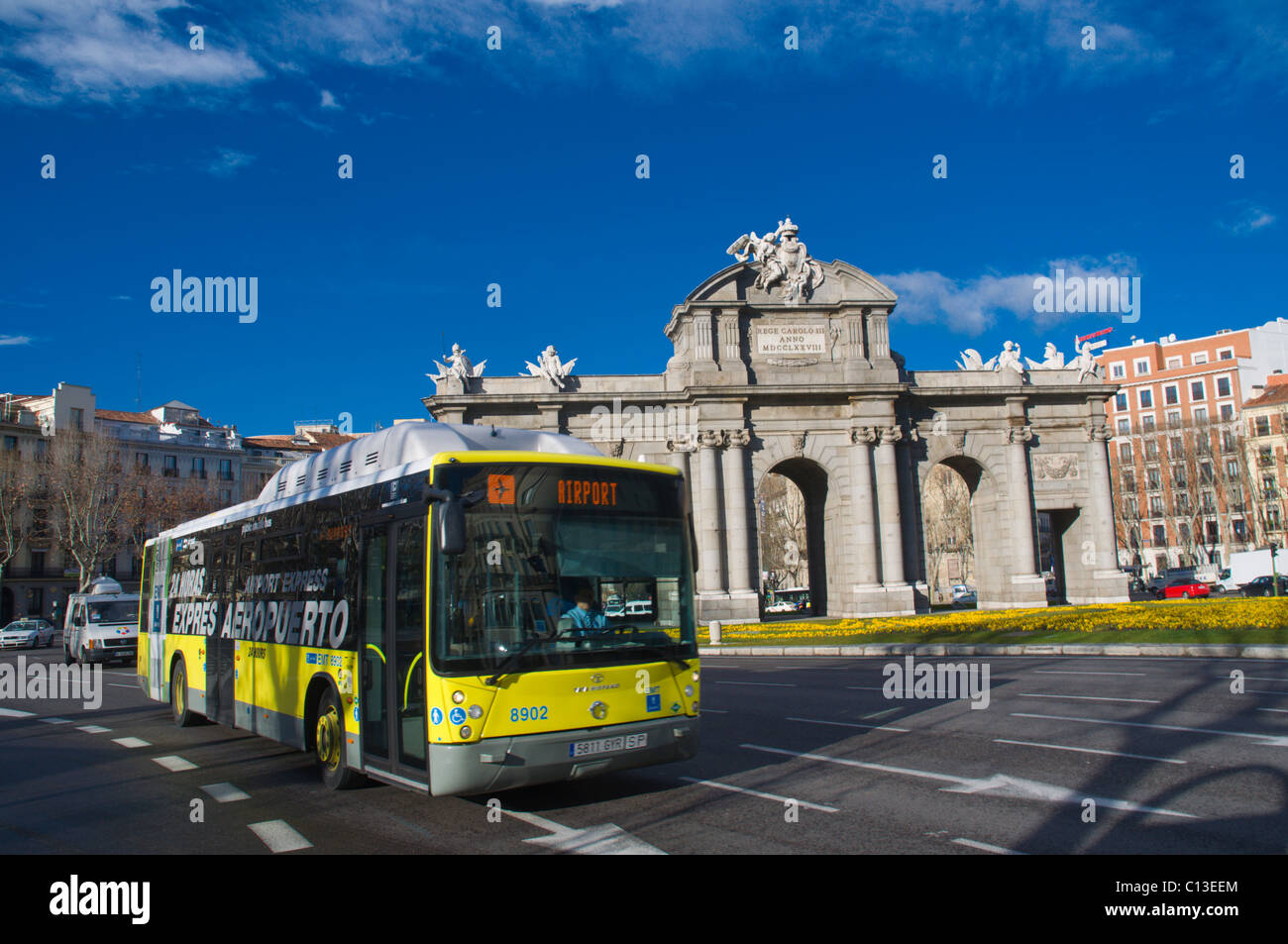 Airport bus at Plaza de la Independencia square roundabout central Madrid Spain Europe - Stock Image
