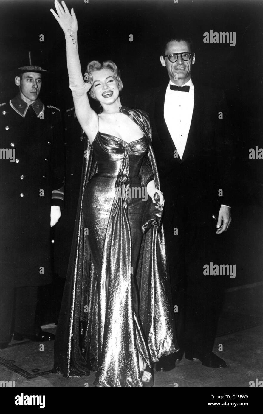 Marilyn Monroe waves to the crowd standing next to husband Arthur ...